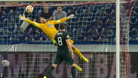 Celtic goalkeeper Craig Gordon makes a save