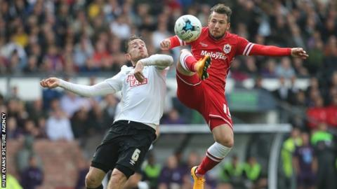 Cardiff City's Adam Le Fondre is challenged by Derby County's Richard Keogh