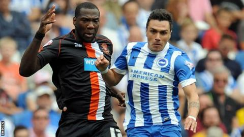 Blackpool's Ishmael Miller (left) and Brighton & Hove Albion's Adrian Colunga battle for the ball