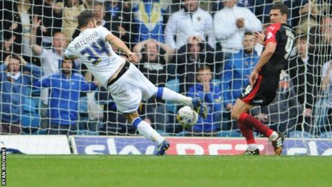 Mirco Antenucci scores the second goal in Leeds United's win over Huddersfield Town