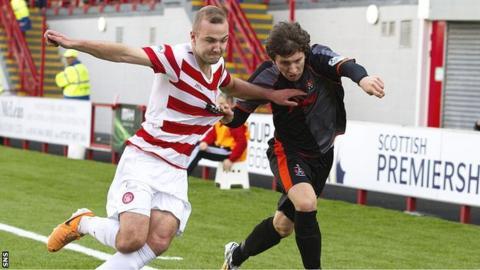 Kilmarnock's Chris Johnston tries to fight his way past Grant Gillespie