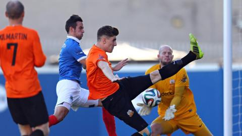 Linfield striker Andy Waterworth puts pressure on Paddy McNally at Windsor Park as Glenavon keeper Alan Blayney prepares to catch the ball