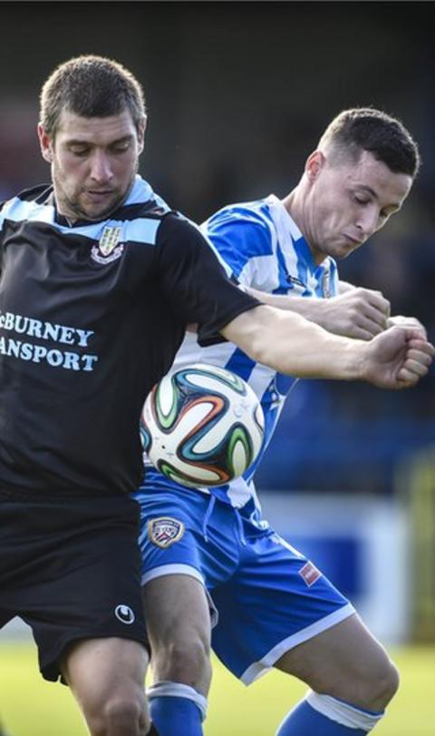 Ballymena forward Matthew Tipton and Coleraine midfielder Ruairi Harkin battle for possession in the derby clash