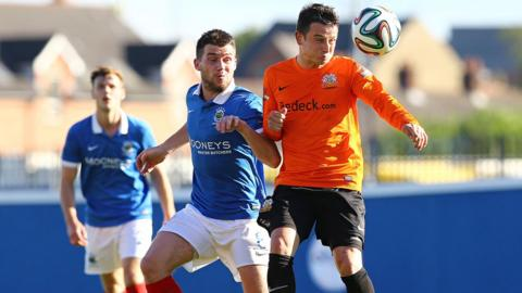 Linfield's Stephen Lowry and Shane McCabe of Glenavon in a midfielder tussle at Windsor Park
