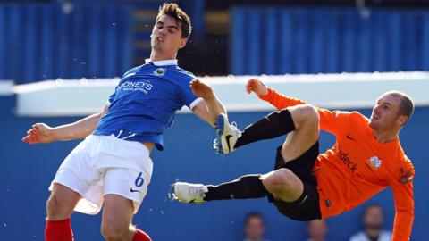 Jimmy Callacher of Linfield in action against Andy Kilmartin during Glenavon's 1-0 win at Windsor Park