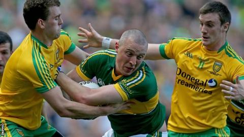 Kieran Donaghy of Kerry in possession against Donegal's Neil McGee and Leo McLoone