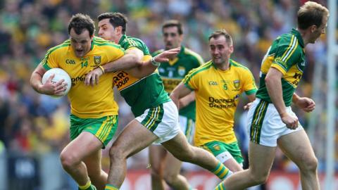 Donegal captain Michael Murphy is hauled back by Kerry defender Aidan O'Mahoney