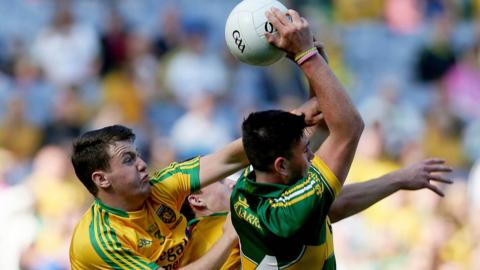 Donegal's Ciaran Gillespie makes the challenge as Liam Kearney catches the ball for Kerry