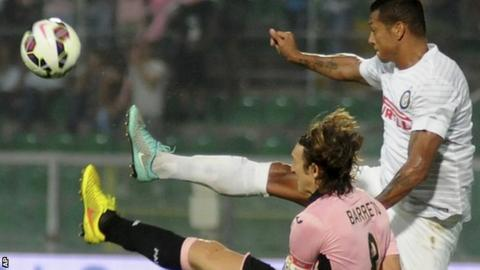 Inter's Fredy Guarín, right, challenges for the ball with Palerm's Edgar Barreto
