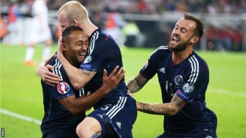Ikechi Anya celebrates his goal with Steven Naismith and Steven Fletcher