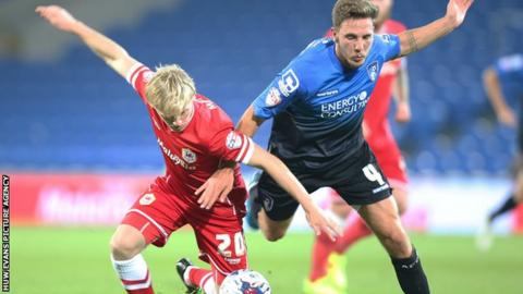 Cardiff's Mats Moller Daehli battles for the ball with Dan Gosling