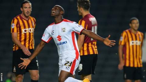 MK Dons' Benik Afobe celebrates after scoring their first goal