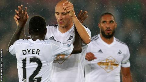 Nathan Dyer celebrates his goal with Jonjo Shelvey