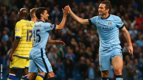 Frank Lampard and Jesus Navas celebrate Manchester City's win against Sheffield Wednesday