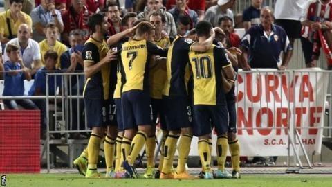 Atletico celebrate Miranda goal