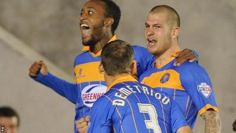 Cameron Gayle (left) and Mickey Demetriou celebrate Shrewsbury's League Cup winner with scorer James Collins