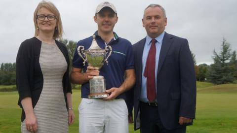 Ulster PGA Champion Colm Moriarty [centre] with Hilton Templepatrick manager Paula Collins and Adrian Byrne, managing director HBE Risk Management