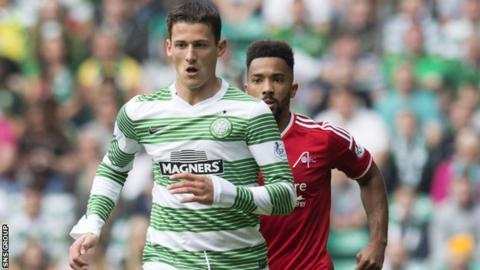 Celtic's Aleksandar Tonev breaks clear of Shay Logan (right)