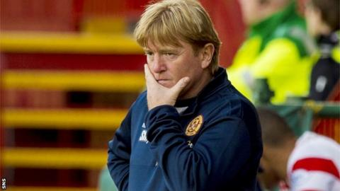 Motherwell manager Stuart McCall ponders a heavy defeat by Hamilton