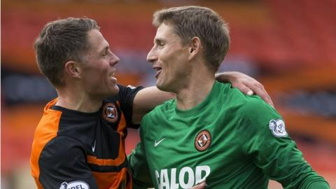 John Rankin and Radoslaw Cierzniak celebrate Dundee United's win