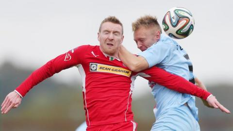 Chris Curran and Stephen McBride battle for the ball as Ballymena's match with Cliftonville ends in a dramatic 2-2 draw