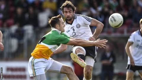 Carrickmore's Mark Donnelly and Omagh's Joe McMahon
