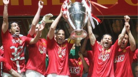 Manchester United players hold aloft the Champions League trophy after winning the tournament in 2008