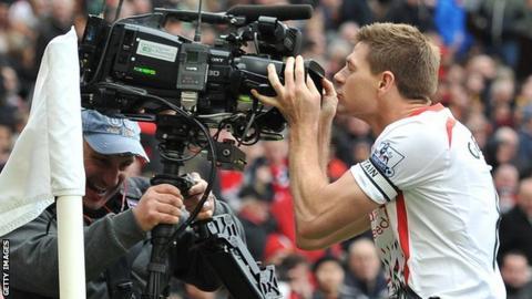 Liverpool captain Steven Gerrard kisses camera