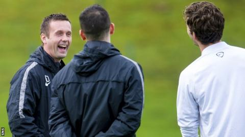 Celtic manager Ronny Deila enjoys a laugh during training