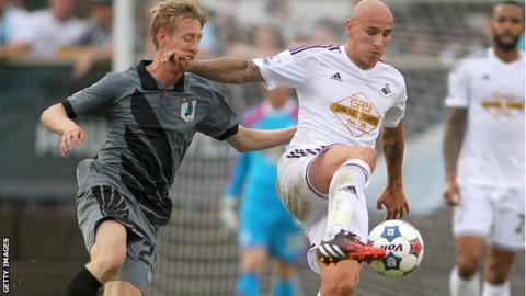 Jonjo Shelvey in action against Minnesota FC's Greg Jordan