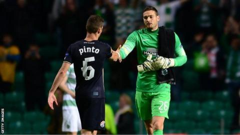 Celtic goalkeeper Craig Gordon and Dinamo Zagreb's Ivo Pinto shake hands