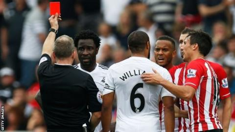 Wilfried Bony is shown a red card