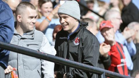 World champion boxer Carl Frampton was at Seaview to cheer on Crusaders but they lost 1-0 to champions Cliftonville