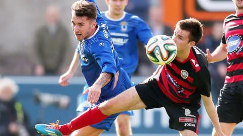 Josh Barton of Dungannon Swifts in action against Coleraine's Adam Mullan