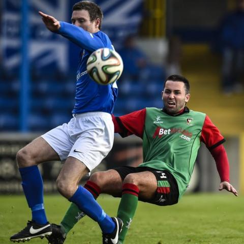 Kevin Braniff of Glenavon in action against Glentoran's Niall Henderson at Mourneview Park