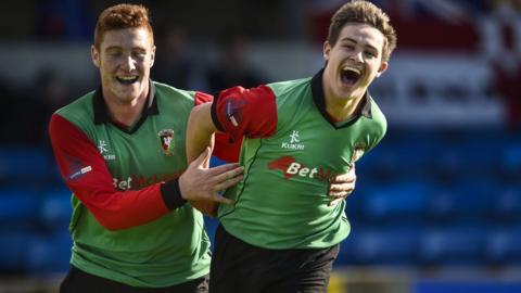 Kym Nelson congratulates Jordan Stewart after the teenager scored the first goal in Glentoran's 2-1 away win over Glenavon