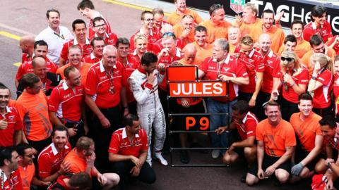 Jules Bianchi celebrates with his team following his 9th place finish at the Monaco Grand Prix.