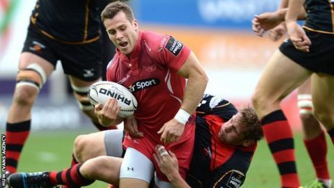Gareth Davies is tackled by T Rhys Thomas