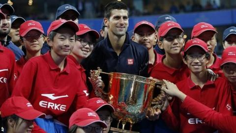 Novak Djokovic celebrates his fifth China Open triumph