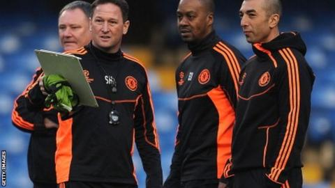Roberto Di Matteo (right), interim first team coach talks with his assistants Eddie Newton (second right) and Steve Holland (second left)