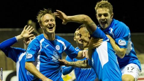 Derek Lyle is mobbed by team-mates after heading Queen of the South into a 3-2 lead