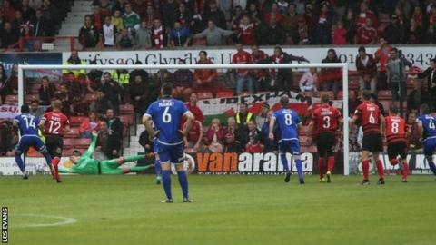 Lenell John-Lewis holds his nerve from the penalty spot to spoil Wrexham's 150th birthday celebrations