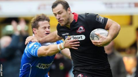 Tim Visser goes past Hallam Amos to score a try for Edinburgh