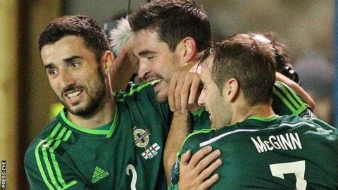 Northern Ireland players congratulate Kyle Lafferty on his 11th international goal