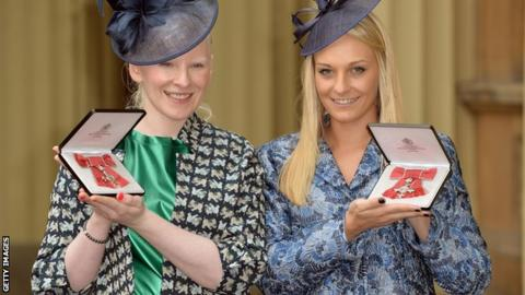 Kelly Gallagher and guide Charlotte Evans with their MBEs at Buckingham Palace