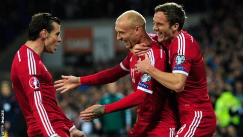 David Cotterill (centre) celebrates his goal with Gareth Bale and Andy King
