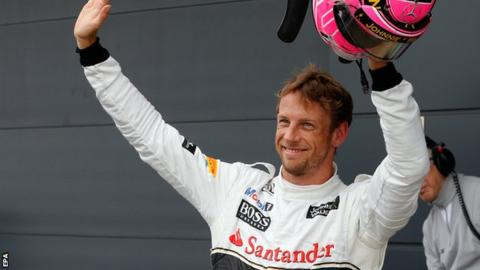 Jenson Button celebrates after taking third position in the qualifying session at Silverstone