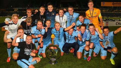 Manchester City players celebrate after winning the 2014 Continental Cup