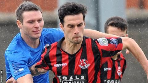 Glenavon's Kevin Braniff in action against Declan Caddell of Crusaders