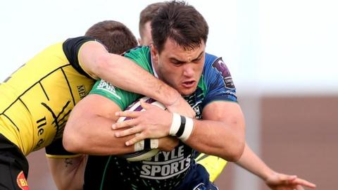 Connacht's Quinn Roux is challenged by Hamish Gard and Lancelot Luteau of La Rochelle